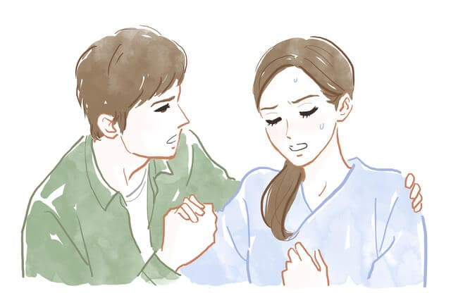 妻を介抱する夫