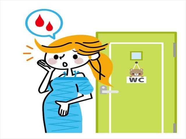 出血する妊婦
